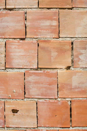 Red simple brick masonry background with lined texture