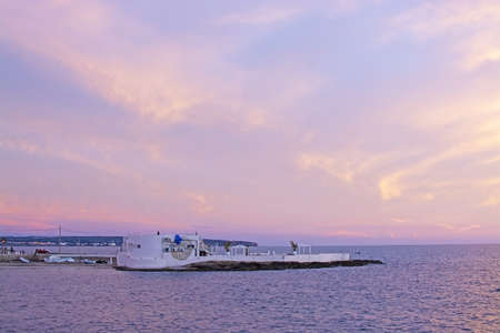 MALLORCA, SPAIN - NOVEMBER 24, 2018: Puro Beach closed for the season under powdery pink sunset skies and ocean with horizon on November 24, 2018 in Mallorca, Spain. Editoriali