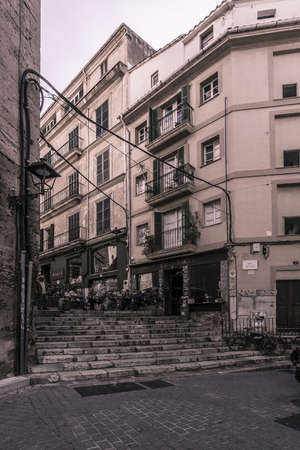 PALMA DE MALLORCA, SPAIN - FEBRUARY 9, 2019: Cafe Antiquari and Babel with people on  a winter day on February 9, 2019 in Palma de Mallorca, Spain. Edgy vintage effect. 에디토리얼