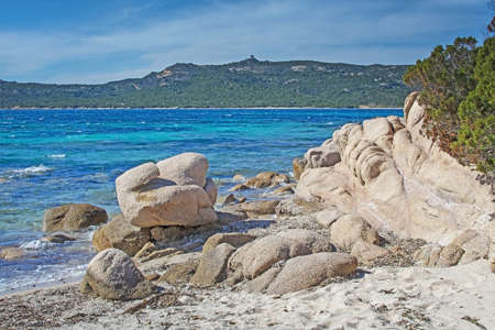 Green water and funny granite rock shapes on a beach in Costa Smeralda, Sardinia, Italy in March.