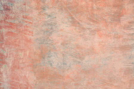 Grungy roughcast wall texture scratchy background in reds, oranges and greens toned in trend color Living Coral.