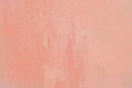 Grungy red roughcast wall scratchy background texture toned in trend color Living Coral.