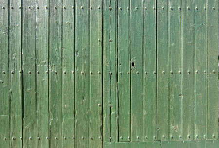 Old green painted rustic wooden wall background texture