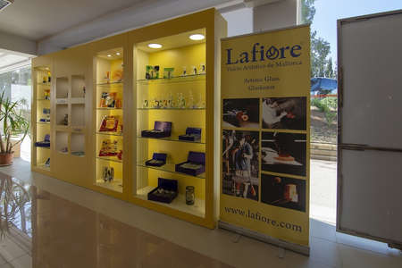 MALLORCA, SPAIN - MAY 16, 2019: Stand presenting Lafiore artisan glass at pearl factory outlet on May 16, 2019 in Porto Cristo, Mallorca, Spain. Editorial