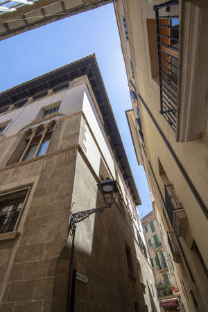 Old Town architecture against blue sky on a sunny day in Palma, Mallorca, Spain.