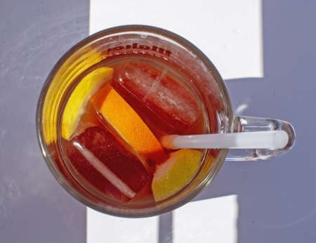 Sangria drink with orange slices in glass on a sunny day at sea in Mallorca, Spain.