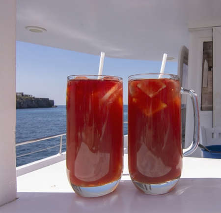 Sangria drinks in glasses on boat on a sunny day at sea in Mallorca, Spain.