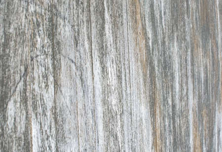 Rustic brown boardwalk wooden jetty wall with gray and brown textured planks