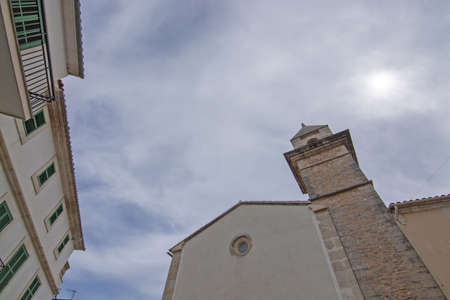 Street view tower against the sky in village on an overcast day in Mallorca, Spain