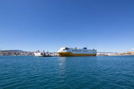 PALMA, MALLORCA, SPAIN - MAY 20, 2019: Freight ship Grande Europa from Grimaldi lines Palermo in Palma port on a sunny day on May 20, 2019 in Palma, Mallorca, Spain. 報道画像
