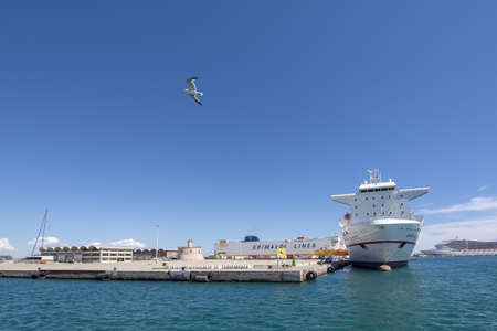 PALMA, MALLORCA, SPAIN - MAY 20, 2019: Freight ship Super Fast Levante from Tenerife moored in Palma port on a sunny day on May 20, 2019 in Palma, Mallorca, Spain. 報道画像