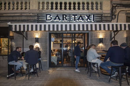 PALMA DE MALLORCA, SPAIN - APRIL 26, 2019: Restaurant Bar Taxi exterior at night on April 26, 2019 in Palma de Mallorca, Spain.