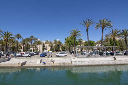 PALMA, MALLORCA, SPAIN - MAY 20, 2019: La Llotja and car park on Paseo Maritimo and palms on a sunny day on May 20, 2019 in Palma, Mallorca, Spain. 報道画像
