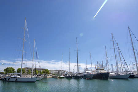 PALMA, MALLORCA, SPAIN - MAY 20, 2019: Old Palma harbor Moll Vell with moored large yachts and vessels on a sunny day on May 20, 2019 in Palma, Mallorca, Spain. 報道画像