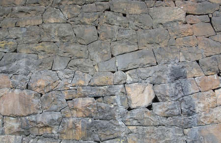 Massive red and gray stone wall with granite and gneiss rocks with high iron content, Sweden. 写真素材