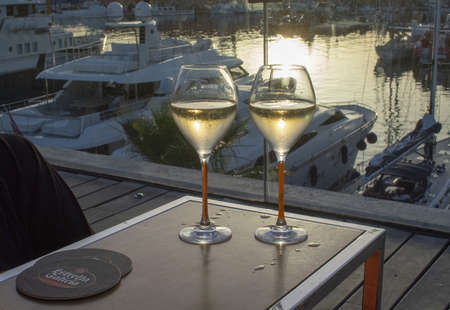 PALMA DE MALLORCA, SPAIN - JUNE 23, 2019: Two champagne flute glasses Veuve Cliquot at sunset by the marina in sunshine romantic on June 23, 2019 in Mallorca, Spain. Editorial