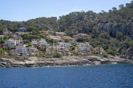 Sunny seaside small homes on a coast in southwest Mallorca, Spain.