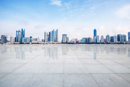 Empty floor with modern skyline and buildings Editorial