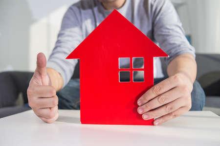 businessmen hold house model in hand Stock Photo - 107755957