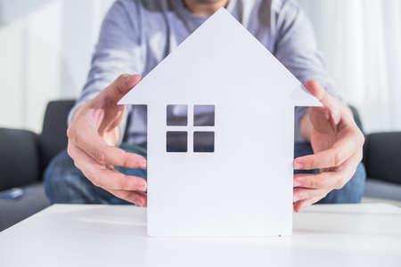 businessmen hold house model in hand Stock Photo - 107755958
