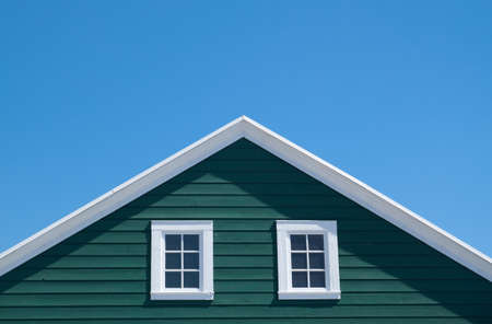 Green house and white roof with blue sky in sunny day Standard-Bild