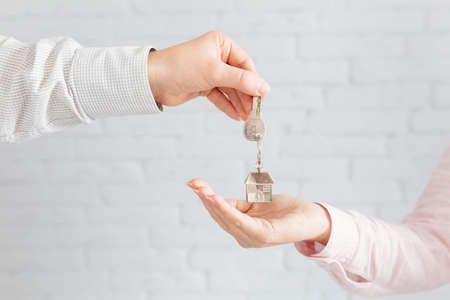 real estate agent key to customer Stock Photo