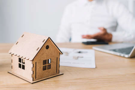 house model and real estate agent Stock Photo - 107744865