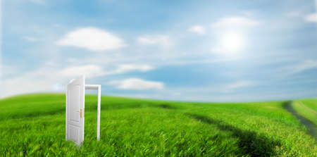 Open door to new life on the field. Hope, success, new life and world concepts.