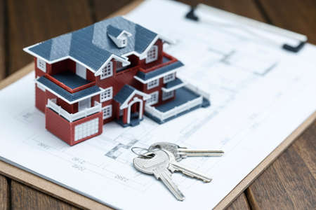 Villa house model, key and drawing on retro desktop (real estate sale concept) Stock Photo - 107779702