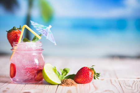 smoothie cocktail on the bea Stock Photo - 107744880