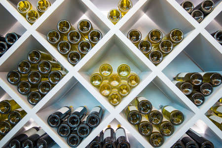 Wines White Wooden Shelve in Wines Cellar. Wines Selection. Stock Photo - 107744881