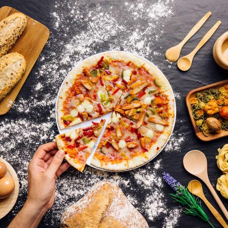 Tasty pizza with ingredients Standard-Bild