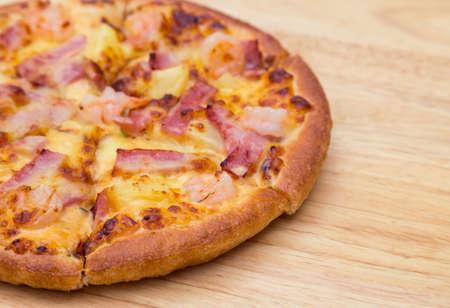 Pizza on wooden background Standard-Bild