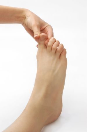 reflexotherapy foot massage on the white background Stock Photo - 6561790