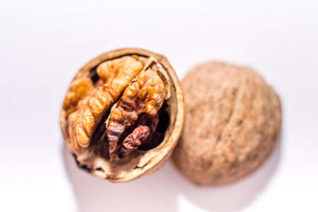 Close up nutmeat and nutshell with shallow depth of field.