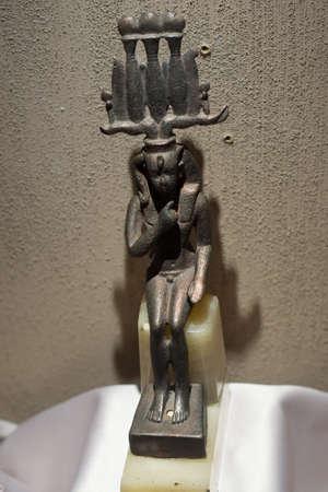 statuette: Ancient Egyptian statuette Editorial