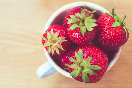 saturated color: Cup of retro looking vibrant delicious strawberries