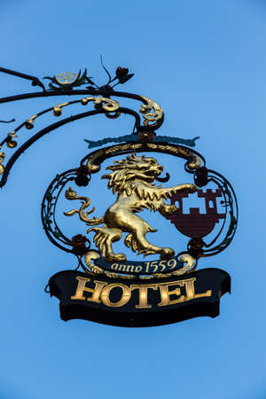 figuring: Gold crest of a hotel figuring a lion in Rothenburg ob der Tauber Stock Photo
