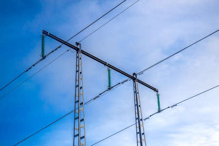 megawatt: High voltage power transmission towers with blue sky in the background