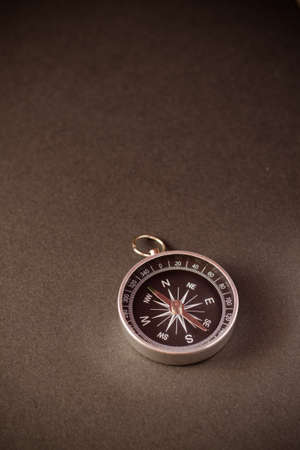 Closeup shot of a shiny metalic compass pointing always to magnetic North