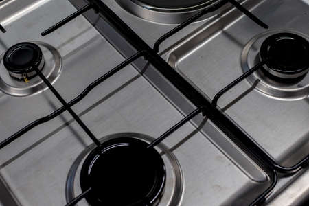 Close up shot of rapid burner on stainless steel gas hob with thin bar pan supports
