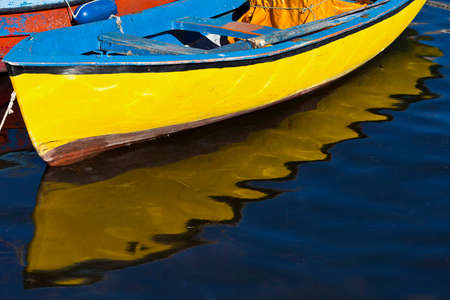 drover: yellow boat with reflection