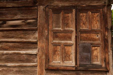 dweling: beautiful old wooden window farmhouse in Bulgaria Stock Photo