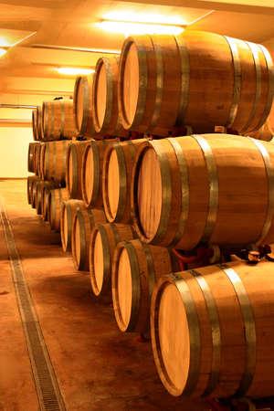 vintage wine cellar full of wine barrels Stock Photo