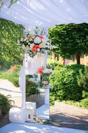 Centrepiece: Wedding reception centerpiece close-up with pastel orange and white