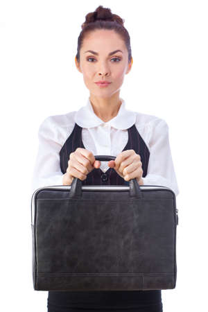 business attire teacher: Successful Serious Caucasian Businesswoman or Teacher  With Briefcase. This photo has been produced with these professionals : make-up artist, hair dresser and stylist. A professional retoucher gave it the final magic touch.