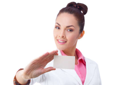 Successful businesswoman in white suit holding blank empty sign. photo
