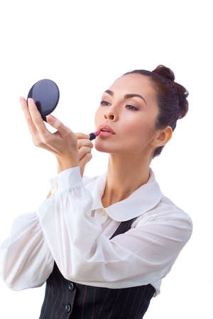 Beauty Girl with Makeup Brushes and Mirror. Natural Make-up for Brunette Woman with Brown Eyes. Beautiful Face. Makeover. Perfect Skin. Applying Makeup