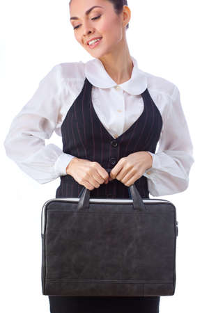 Successful Caucasian Businesswoman or Teacher  With Briefcase. This photo has been produced with these professionals : make-up artist, hair dresser and stylist. A professional retoucher gave it the final magic touch. photo
