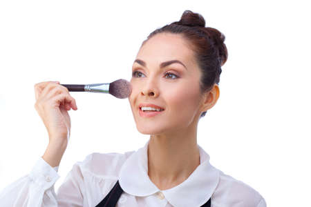 makeover: Beauty Girl with Makeup Brushes. Natural Make-up for Brunette Woman with Brown Eyes. Beautiful Face. Makeover. Perfect Skin. Applying Makeup Stock Photo